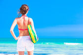 Woman in bikini and sunglasses with beach bag — Stock Photo