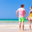 Couple in bright clothes on tropical beach in Thailand — Stock Photo