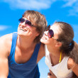 Closeup of happy young couple in sunglasses smiling — Stock Photo