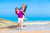 Picture of happy couple in sunglasses on the beach — Stock Photo