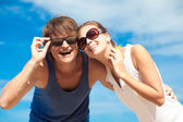 Young couple in sunglasses — Stock Photo