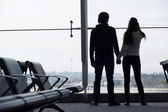 Couple waiting at airport terminal — Stock Photo