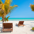 Two Beach Chairs near palm trees on tropical Holbox island Mexico — Stock Photo #42459189