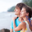 Portrait of happy young couple enjoying their time on tropical beach in the evening — Stock Photo #42642011