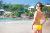 Front view of fit young woman in yellow bikini — Stock Photo