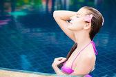 Half face portrait of beautiful woman in luxury pool — Stock Photo