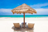 Two beach chairs and umbrella on sand beach. Holidays — Stock Photo