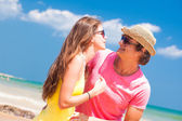 Happy young couple on beach looking at each other — Stock Photo
