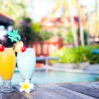 Two glasses of cocktails near pool. party — Stock Photo
