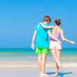 Back view of happy young couple at tropical beach — Stock Photo #47406471