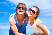 Happy young couple hugging at tropical beach — Stock Photo