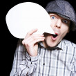Retro Paperboy Making Speech Bubble Announcement - Stockfoto