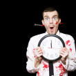 Halloween Ghoul Holding Clock Set To Midnight - Stock Photo