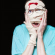 Shocked Patient Nursing A Broken And Bloody Head - Foto de Stock
