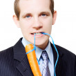 Stock Photo: White background business person dangling carrot