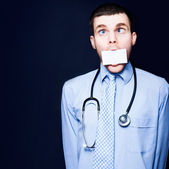 Crazy Pediatrician Doctor With Business Card Mouth — Stock Photo