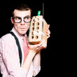 Stock Photo: Male Nerd Inventor Holding Brick Mobile Telephone