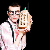 Male Nerd Inventor Holding Brick Mobile Telephone — Stock Photo