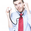 Stock Photo: Medical Doctor Using Stethoscope During Checkup