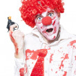 Stock Photo: Evil Clown Holding Cap Gun On White Background