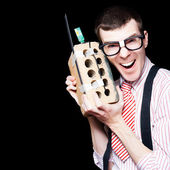 Business Geek Laughing On House Brick Phone — Стоковое фото