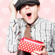 School Boy In Love Holding Valentines Day Present — Stock Photo #13386114