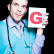 Male Gynaecologist Doctor Holding Gynaecology Sign - Stock Photo
