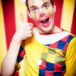 Royalty-Free Stock Photo: Smiling Circus Clown Standing Inside Bigtop Tent