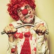 Possessed Horror Clown With Supernatural Strength - Stock Photo