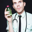 Doctor Holding Cold And Flu Cough Medicine — Stock Photo