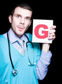 Male Gynaecologist Doctor Holding Gynaecology Sign — Stock Photo