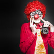 Stock Photo: Fun Smiling Clown Holding CamerTaking Happy Snap