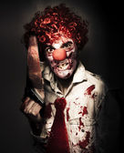 Angry Horror Clown Holding Butcher Saw In Darkness — Stok fotoğraf