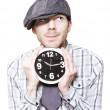 Young School Boy Watching Time While Holding Clock — Stok fotoğraf
