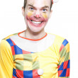 Joker In Clown Costume Laughing At Kids Birthday - Stock Photo