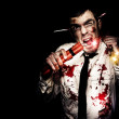Crazy Zombie Businessman With Dynamite Explosives - Stock Photo