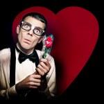 Romantic Nerd Holding Rose On Love Heart Background — Stock Photo