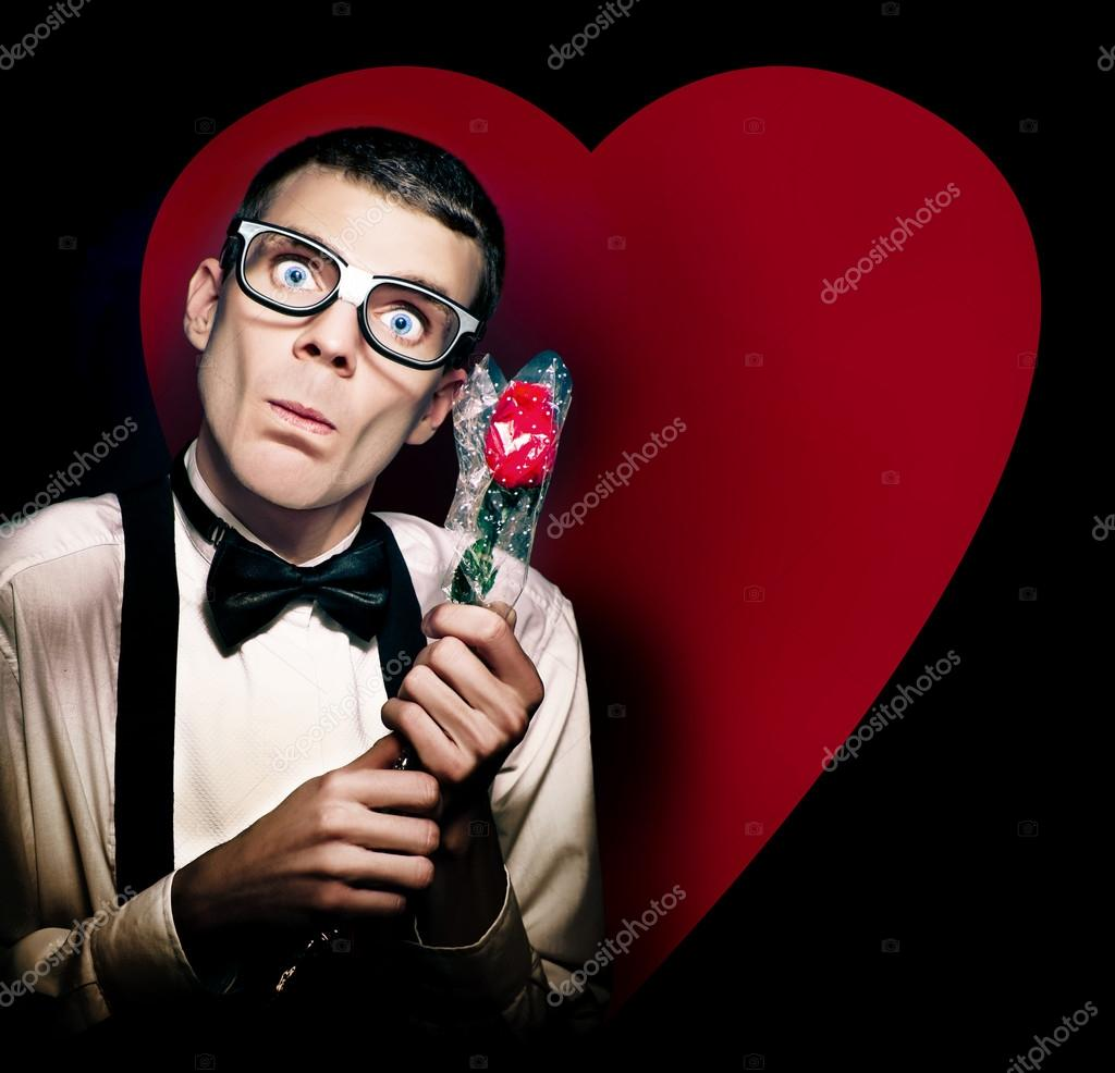 Romantic Valentines Day Nerd Holding Rose On Love Heart Background — Stock Photo #14038936