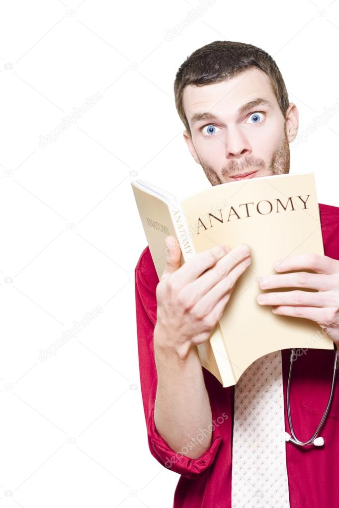 Humorous Healthcare Image Of A Young Medical Intern Student Studying Anatomy Textbook With A Expression Of Surprise — Stock Photo #14339625