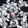 Royalty-Free Stock Photo: Crazy Clown Excited To Hold A Bag Of Money