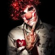 图库照片: Evil Blood Stained Clown Contemplating Homicide