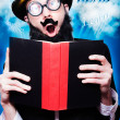 Stock Photo: Funny Wizard Reading Magic Book Of Inspiration