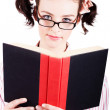 Stock Photo: Studious School Student Reading Text Book On White
