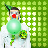 Crazy Party Clown Inflating Green Party Balloon — Stock Photo