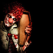 Evil Horrible Clown Holding Coffin In Darkness — Stock Photo