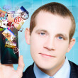 Royalty-Free Stock Photo: Business Man Steaming Media Apps On Smart Phone