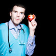 Stock Photo: Healthy Eating Metaphor With Doctor Holding Apple