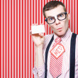 Nerdy 60s Salesman Holding Business Card - Stock Photo