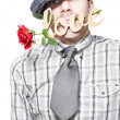 Funny Man Saying Sorry With Love And A Red Rose - Stock Photo