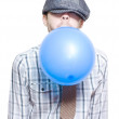 Party Boy Blowing Up New Years Eve Balloon - Stockfoto
